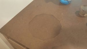 Heat damage from hot pan over Quartz surface- before repair pic